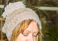 fluffy jumper into a hat with a pompom