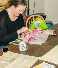 Zoe working on her cross stitch.