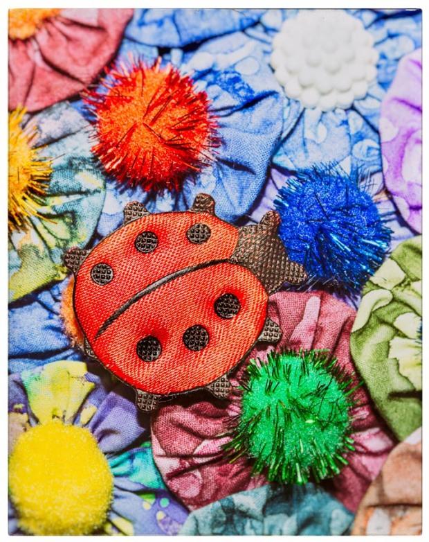 fabric yo yos with pom poms