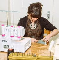 Tara using the Serger - which looks challenging to thread up!