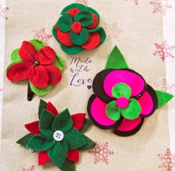some hairclips in Christmas colours but can be worn anytime - made by a stitchee